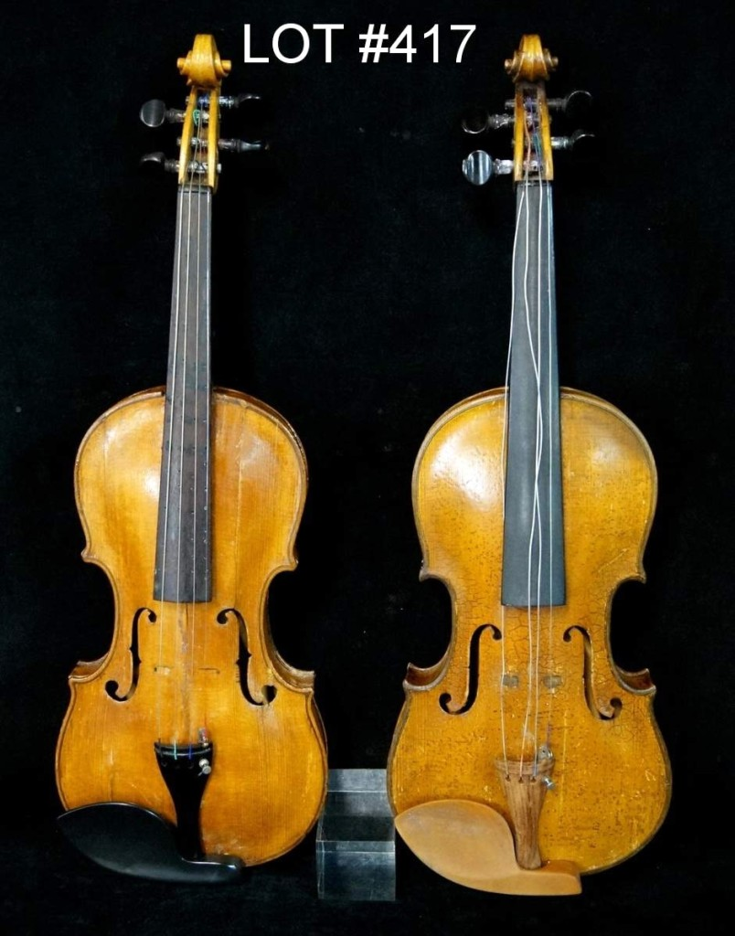 Lot 417 was a lot of two violins, one of which is rather unique with the back covered in pyrographic decoration and housed in a double case with a purple lining.