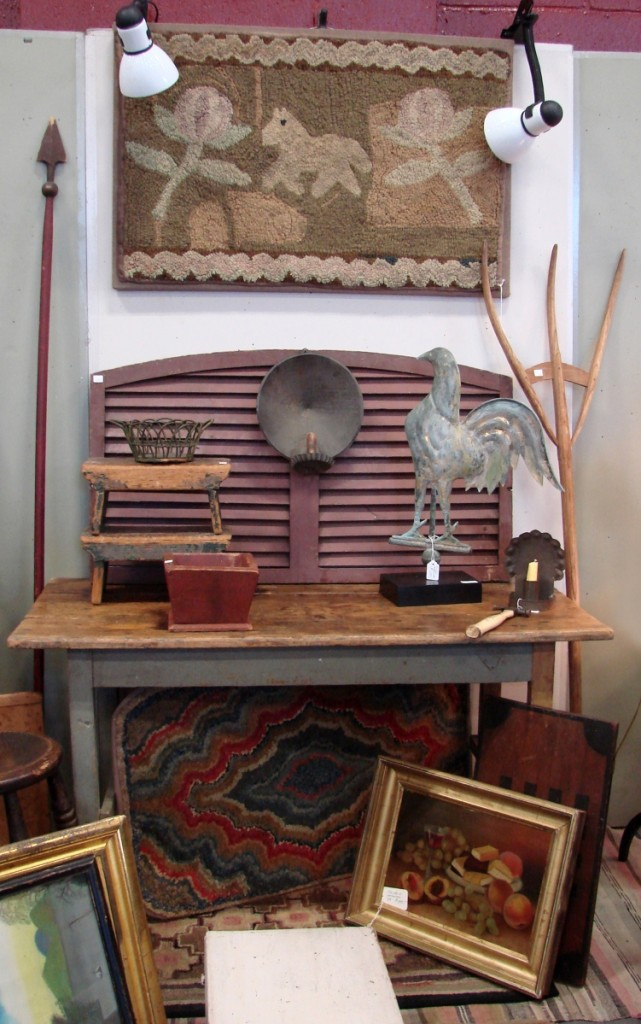 Latchpenny Antiques, Rochester, N.Y., had hooked rugs and country accessories.