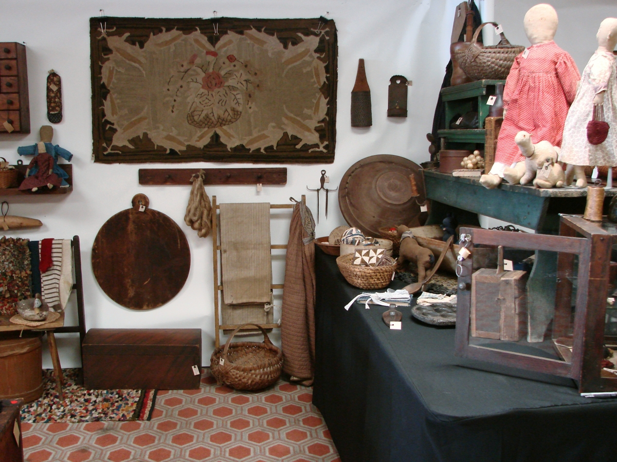 Sandy Elliott, Brentwood, N.H., brought several early cloth animals, cloth dolls, country textiles and more.