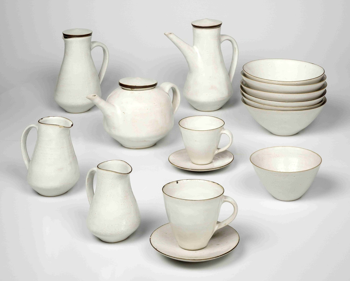 "According to Adamson, not only does this service represent a potter ""so important in the exhibition,"" but it also stands for ""studio potters in conversation with industry."" He noted the one-to-one relationships between the pieces and as well as the impact of the set as a whole. ""It is very compositional."" Breakfast set by Lucie Rie, late 1950s. Stoneware, white glaze and manganese oxide applied in bands. Crafts Study Centre, Farnham."