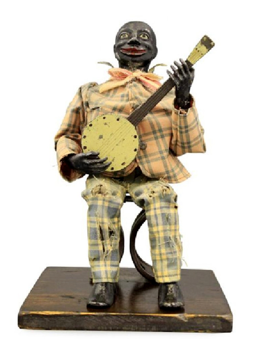 This Seated Banjo Player made by Jerome Secor, Bridgeport, Conn., circa 1875, 10 inches tall, is of zinc, iron, brass, fabric and wood, measures 10 inches tall, sold for $18,000, exceeding the $15,000 high estimate. Secor's banjo player not only appears to strum the instrument, but he also keeps time with his foot and sways his head and shoulders.