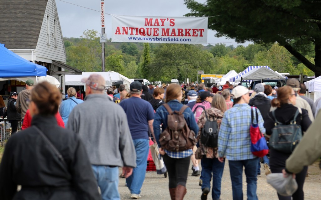 """""""At May's, everyone's an early buyer"""" reads the slogan of May's Antique Market, one of the oldest shows at Brimfield. Since 1977, a unique policy has guided the show's allure, prohibiting dealers from setting up until the opening bell. This ensures that the best merchandise is available to everyone who stood waiting in line."""