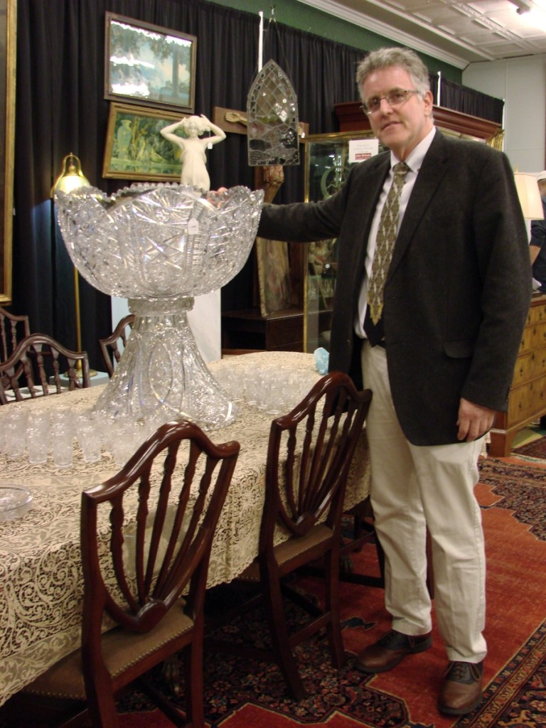 Gallery director Dan Meader with the unique cut glass punch bowl that he discovered on a house call.