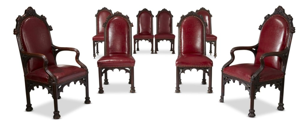 The rare set of 14 Herrick-Maynard-Hatch Gothic Revival carved oak dining chairs, designed by architect Alexander Jackson Davis (1803–1892) for Ericstan, included this lot of eight chairs that went out at $81,250.