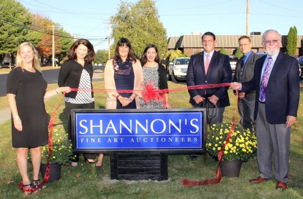 Shannon staffers gathered for the ribbon cutting with New Milford, Conn., Mayor David Gronbach.
