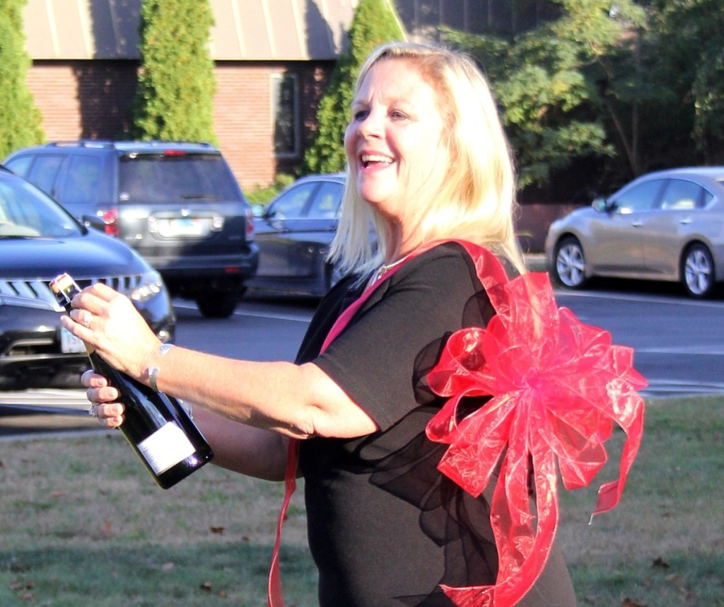 Sandra Germain, co-owner of Shannon's Fine Art Auctioneers, popped the cork in celebration of her firm's new quarters.