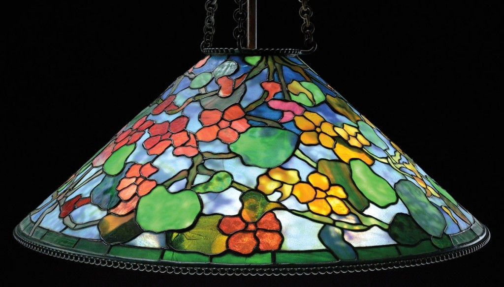 Also bringing $84,700, this signed Tiffany Studios 16-inch Rose and Butterfly table lamp had yellow roses and red butterflies over the roses.