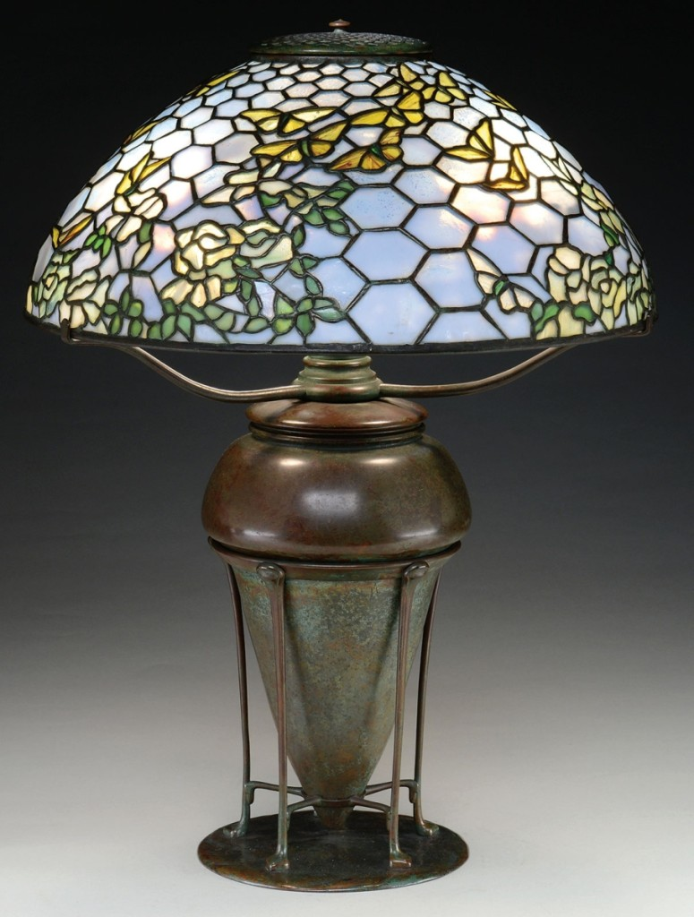 In a three-way tie for the highest priced lot, this signed Tiffany Studios boldly colored Nasturtium pattern chandelier, just under 29 inches in diameter, with mottled yellow and amber flowers and large mottled green leaves, finished at $84,700.