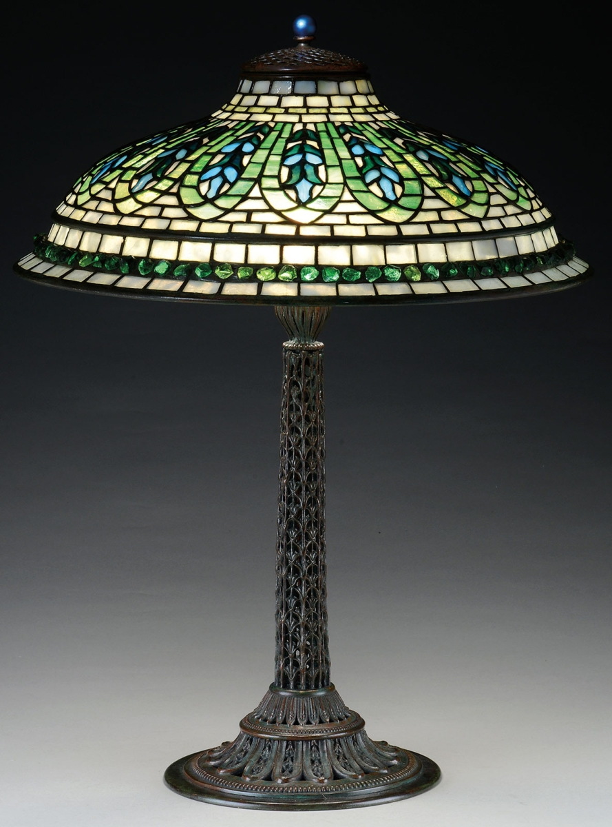 The fourth highest priced Tiffany Studios lamp was a Gentian table lamp. It had blue flowers descending from the neck, and each of the flowers was outlined in mottled green glass. The final price was $81,675, well over the estimate.