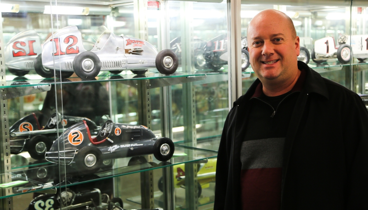 Dan Morphy stands next to the second highest lot in the sale, a Richter Modern Bullet #12 racer, top shelf, that brought $35,670. The car was made of sheet aluminum by Roy Richter, the founder of Bell Helmets.