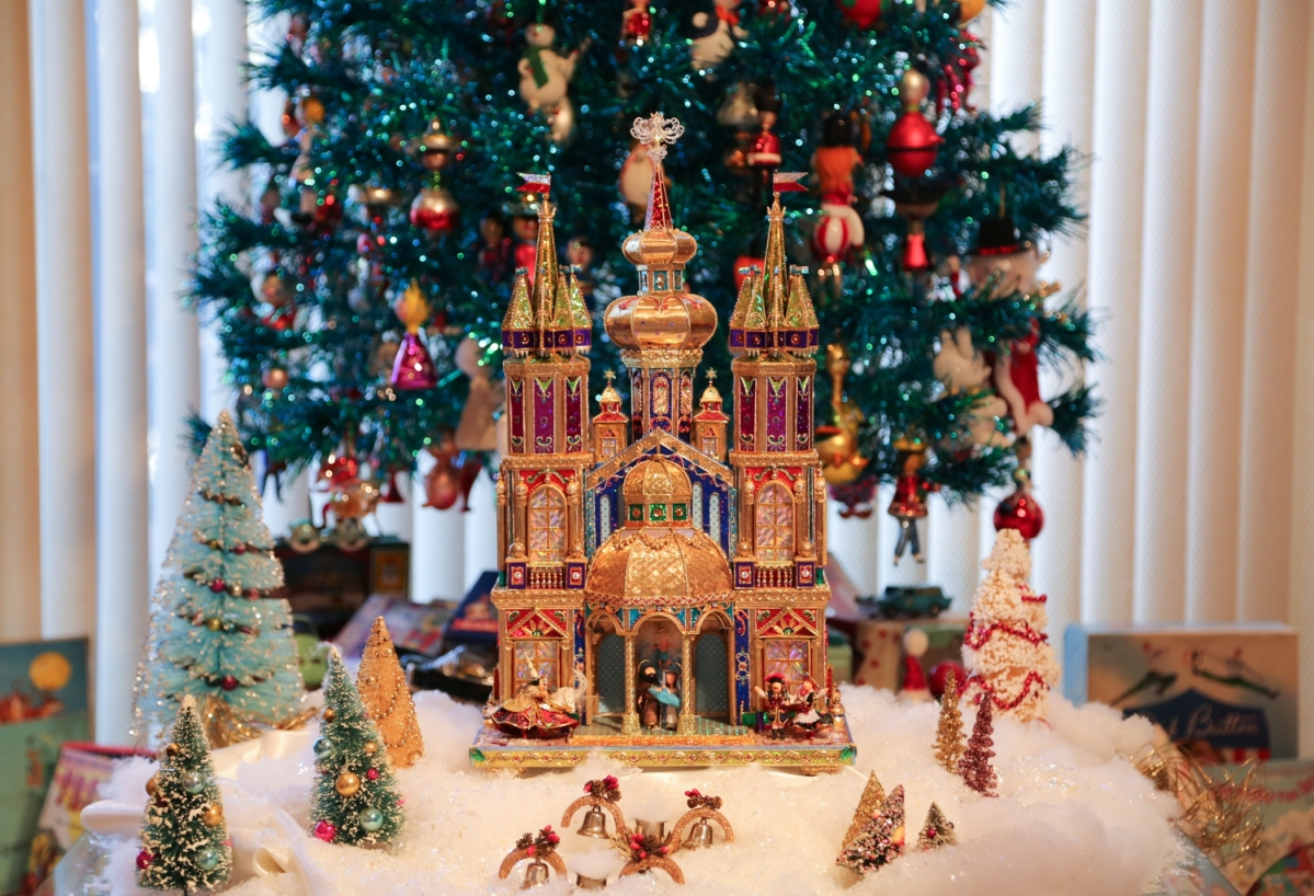 This modern szopka, or nativity, is made of colored tin foil mounted on cardboard and was purchased in a museum store in Krakow, Poland. Making szopki is a competitive tradition among local builders. The maker of this nativity included figures from Polish history.