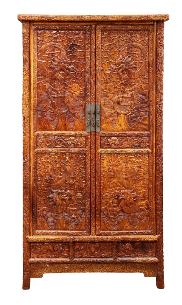 A Chinese huanghuali and mixed wood cabinet sold for $48,400.