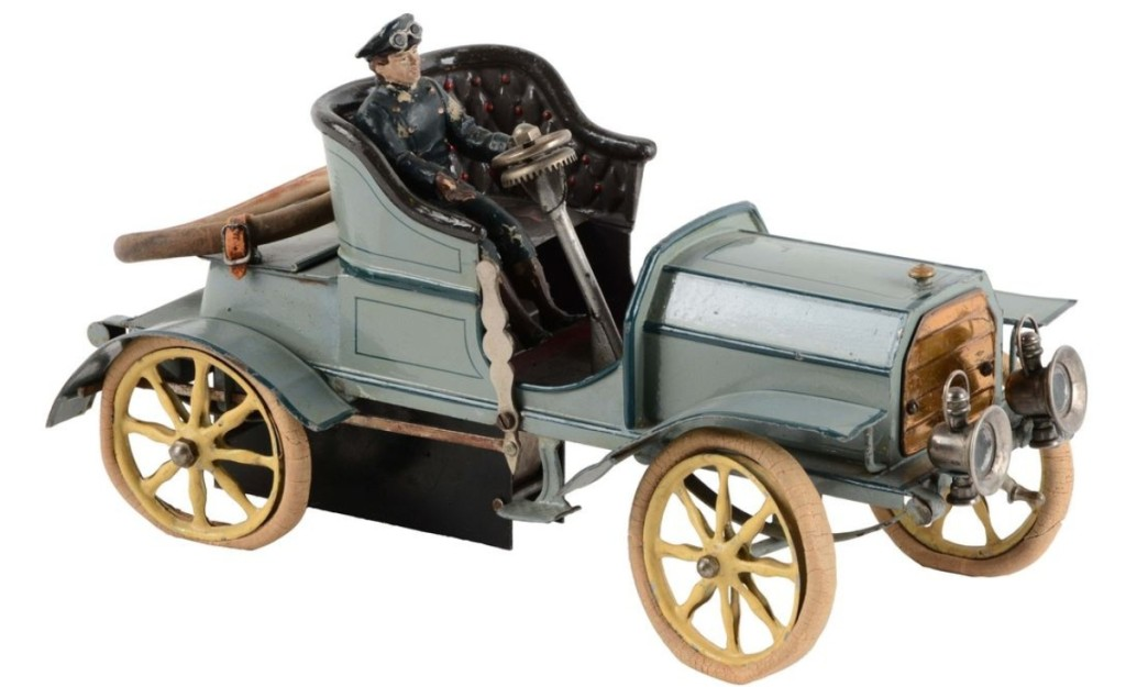 There were a number of extremely high-quality German cars in this sale, and this one, a Marklin hand painted open two-seat roadster, was the best. It was the top lot in the sale at $90,000 as a floor bidder stuck it out against competing phone lines. It was circa 1905 and all original, with open rear tool compartment, leather strapped-down rubber spare tire, nickel finished lamps, driver and clockwork mechanism.