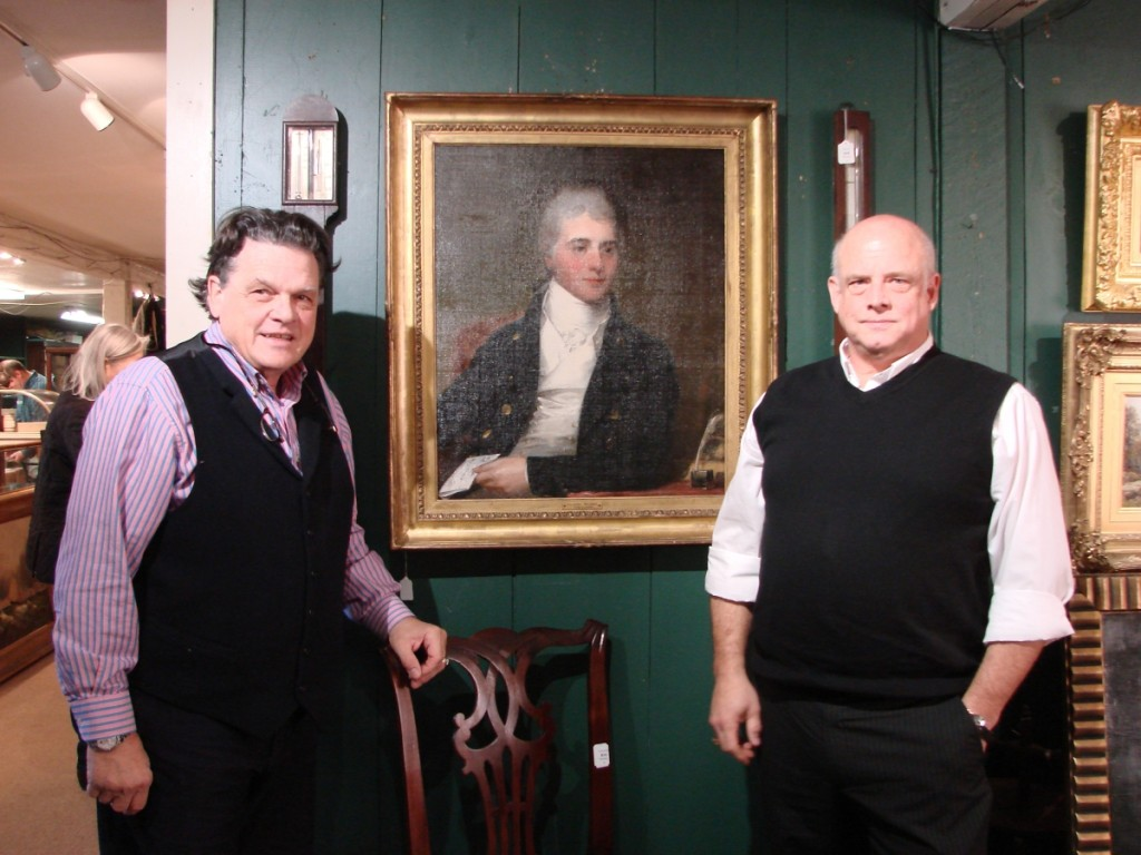 Kaja Veilleux on the left and John Bottero, vice president, on the right. Between them is the Gilbert Stuart portrait that topped the three-day sale.