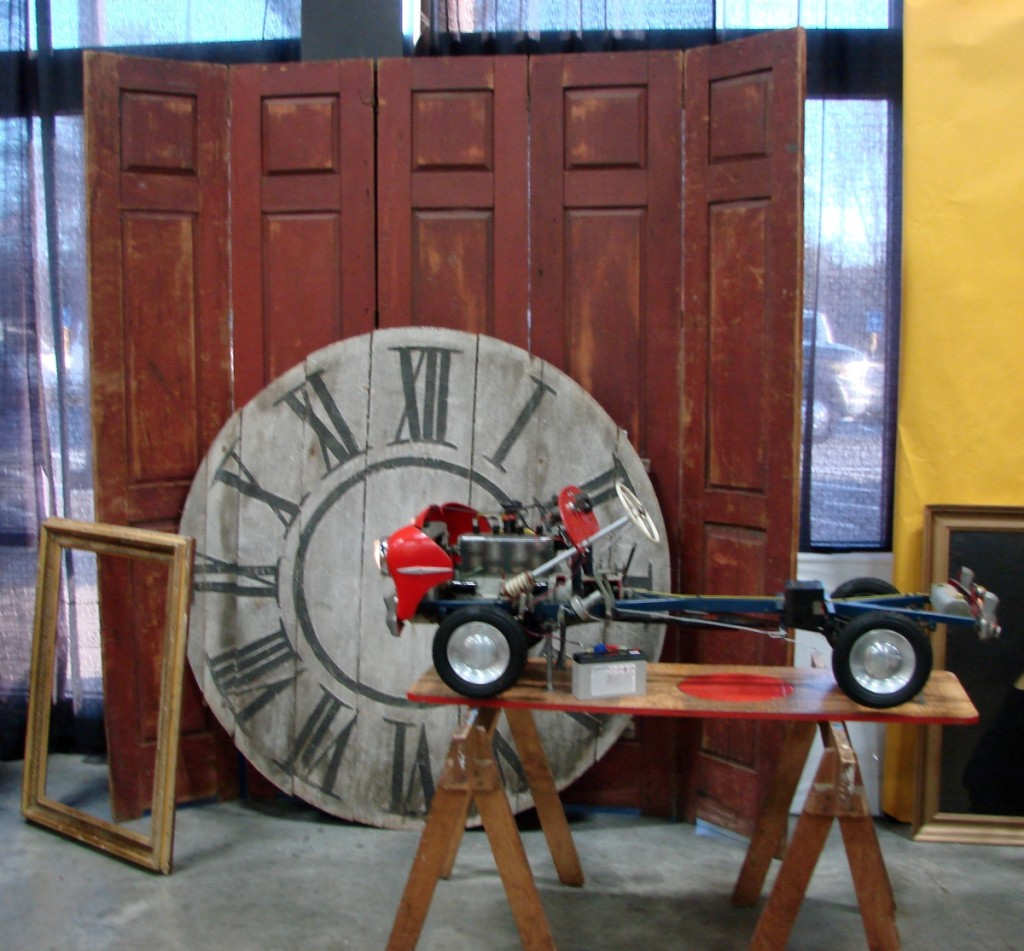 The large clock face was in the booth of Don Heller and Kim Washam, Portland, Maine. It was 56 inches in diameter and came from a circa 1850 tower clock in Cleveland, N.Y. It was priced at $2,600. The driving school model car, with operating details, dated about 100 years later and was priced at $5,300.