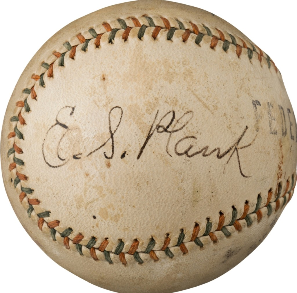 A 1915 Eddie Plank single-signed baseball was one of many spheres that sold over the $100,000 mark; this one sailed to $228,000.