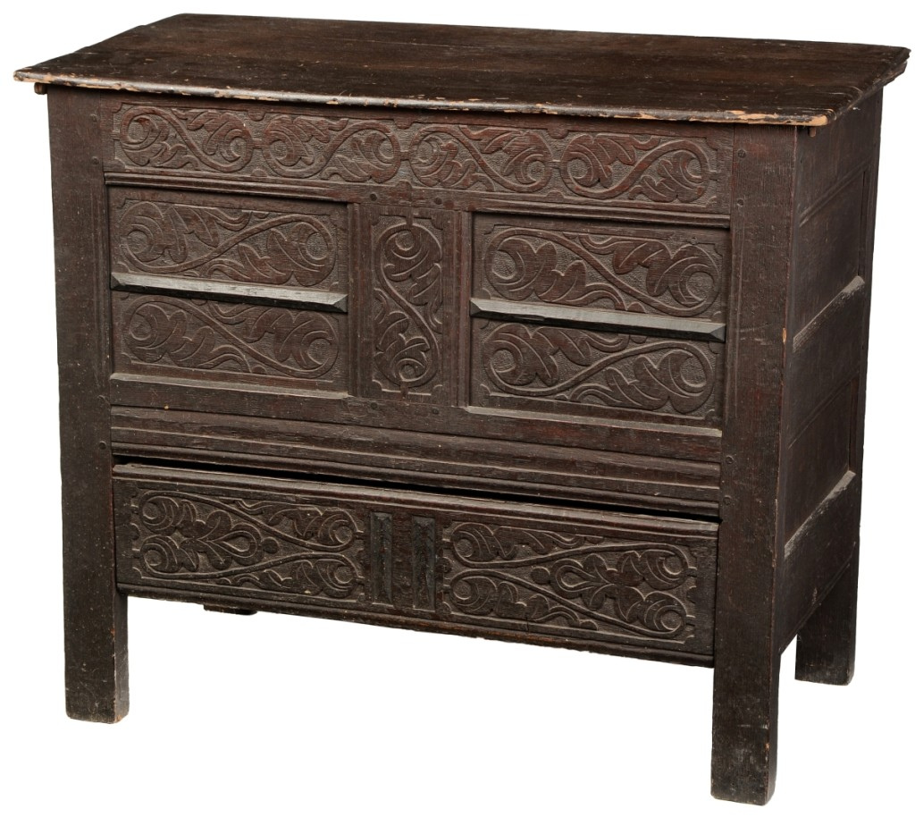 This rare New England Pilgrim Century carved chest, attributed to Guilford, Conn., reached the top price of $168,000.