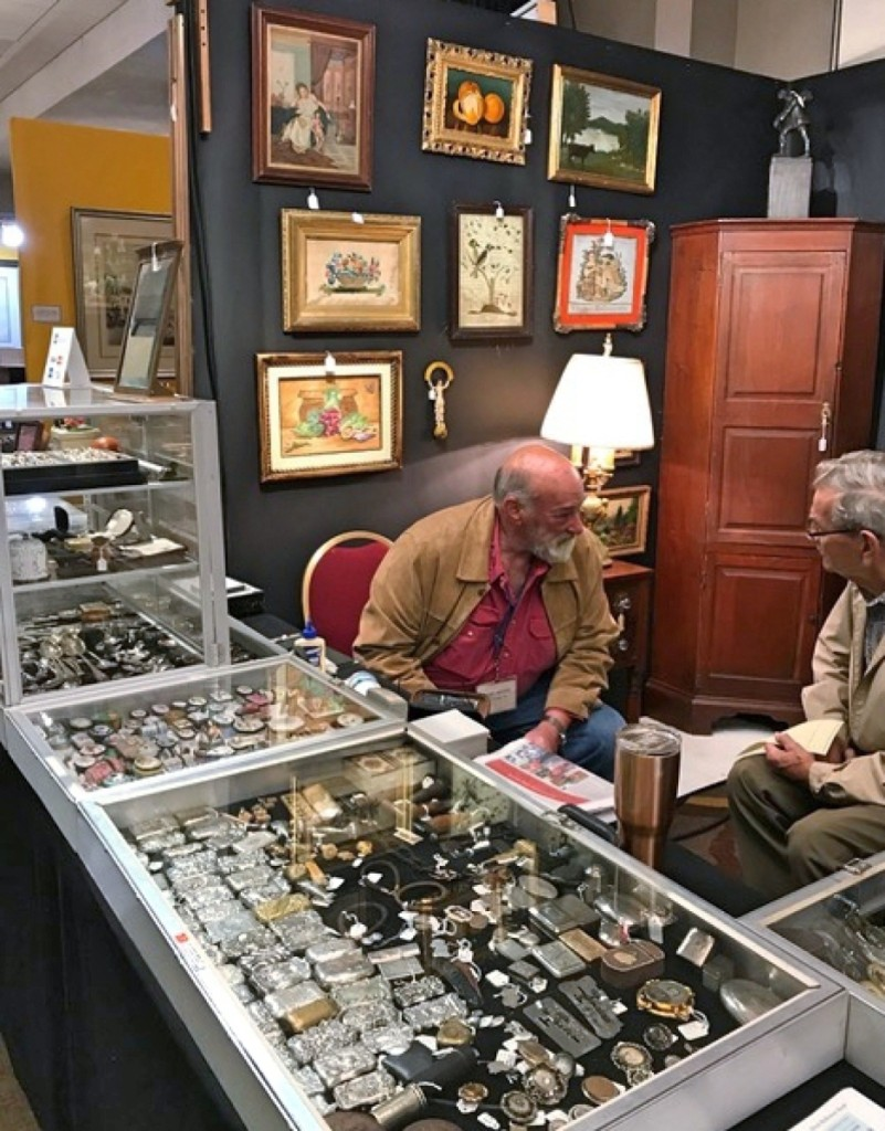 Marc Witus, Gladstone, N.J., left, talks with a customer.
