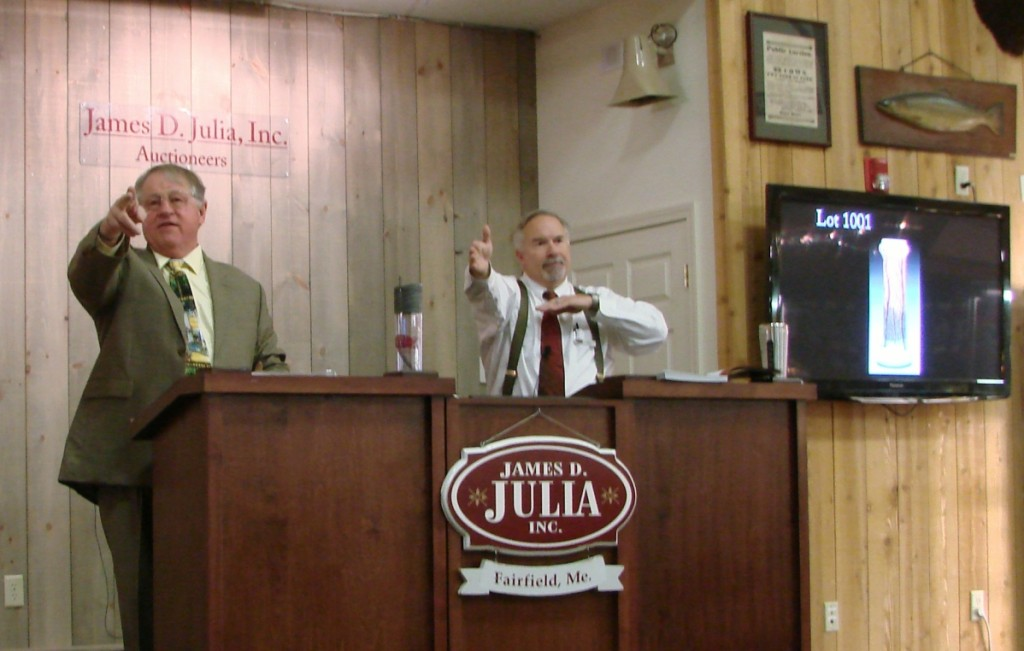 Jim Julia at the podium with Chief Executive Officer Mark Ford assisting.