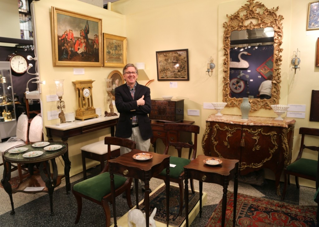 Paul Thien of Firehouse Antiques, Galena, Md., stands in his booth of formal American and continental furniture. The dealer is representing a fine collection that was amassed in the 1920s and 1930s, saying the quality was some of the best he has ever exhibited.