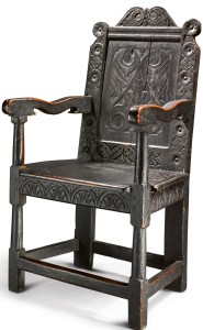 The Mansfield-Merriam family Pilgrim Century black painted carved and joined oak wainscot armchair, New Haven Colony, probably New Haven, Conn., circa 1640–1660 ($300/500,000). —Sotheby's