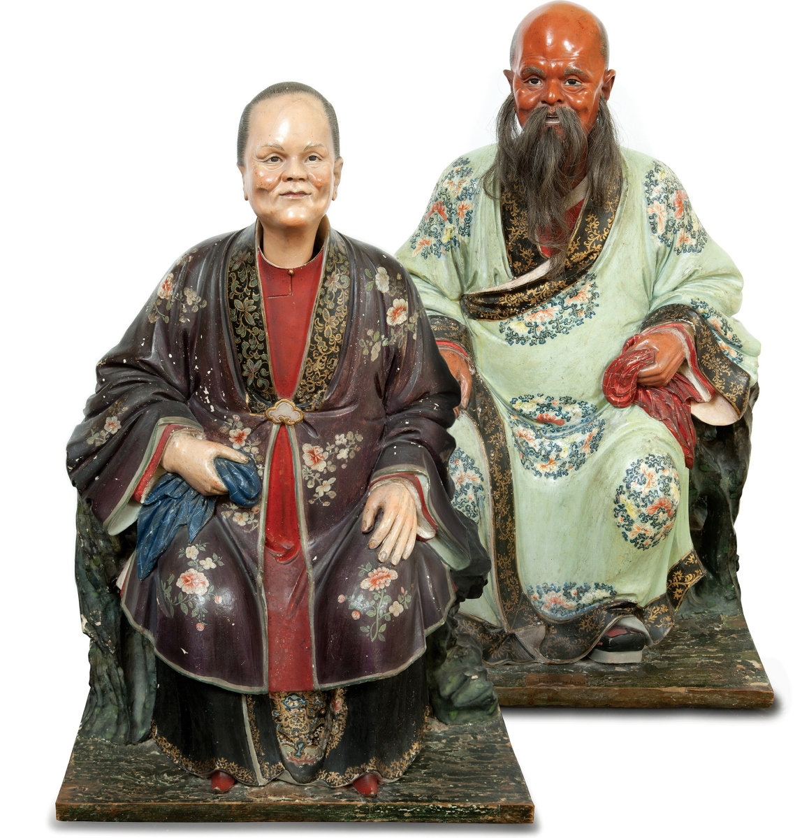 Pair of Chinese Export polychrome-decorated clay nodding head figures, late Eighteenth/early Nineteenth Century realized $162,500.