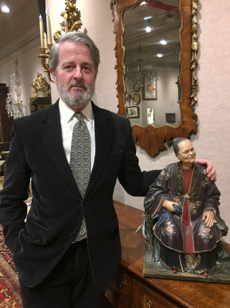 Peter Lang, Doyle senior vice president and director, English and continental furniture and decorative arts, with one of the Chinese nodding head figures.