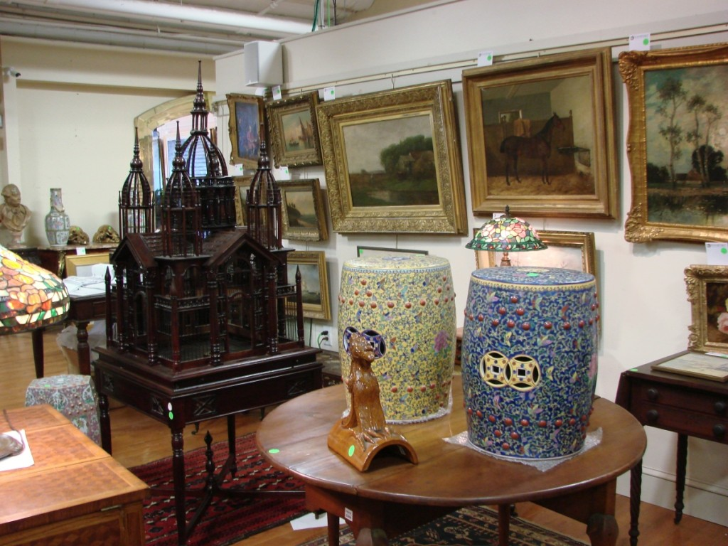 A portion of the material on display during the preview, including the mahogany birdcage and some of the paintings.