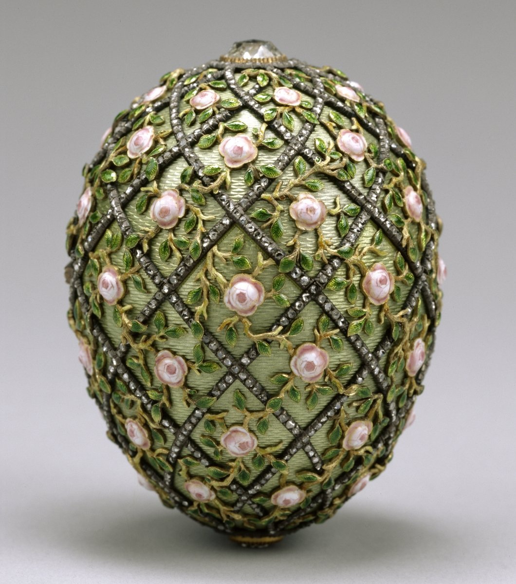 "Made in the Fabergé workshop by Finnish master Henrik Wigström, the Rose Trellis imperial Easter egg was a gift from Tsar Nicholas II (1868–1918) to his wife Alexandra Feodorovna. The date ""1907"" can be seen under a portrait diamond at the apex. Criss-crossed with diamonds, this 3-inch-tall objet d'art originally held as its ""surprise"" a necklace with a miniature of Tsarevich Alexei Nikolaevich, now lost. Acquired from Alexandre Polovtsoff by Henry Walters, 1930."