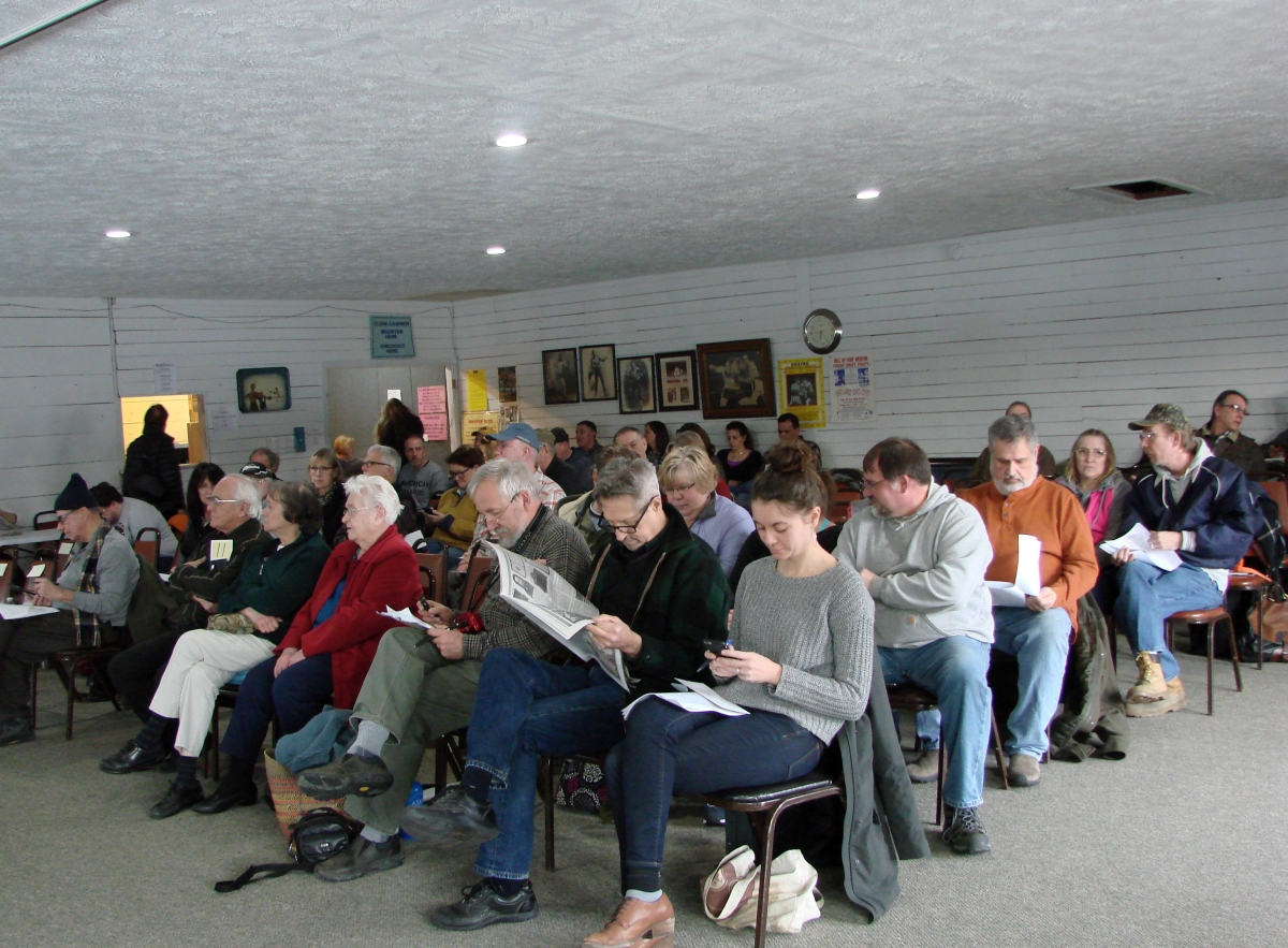 The gallery was full. Buck had advertised the sale well, and there were very few unoccupied seats.