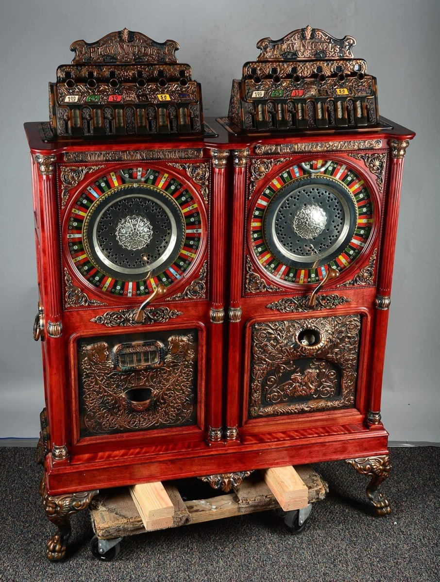 This early 1900s five-cent Caille Centaur Eclipse twin double upright slot machine beat the house with a $98,400 winning bid. Housed in a mahogany cabinet, it is decorated with a Centaur on one side and an Eclipse on the other.
