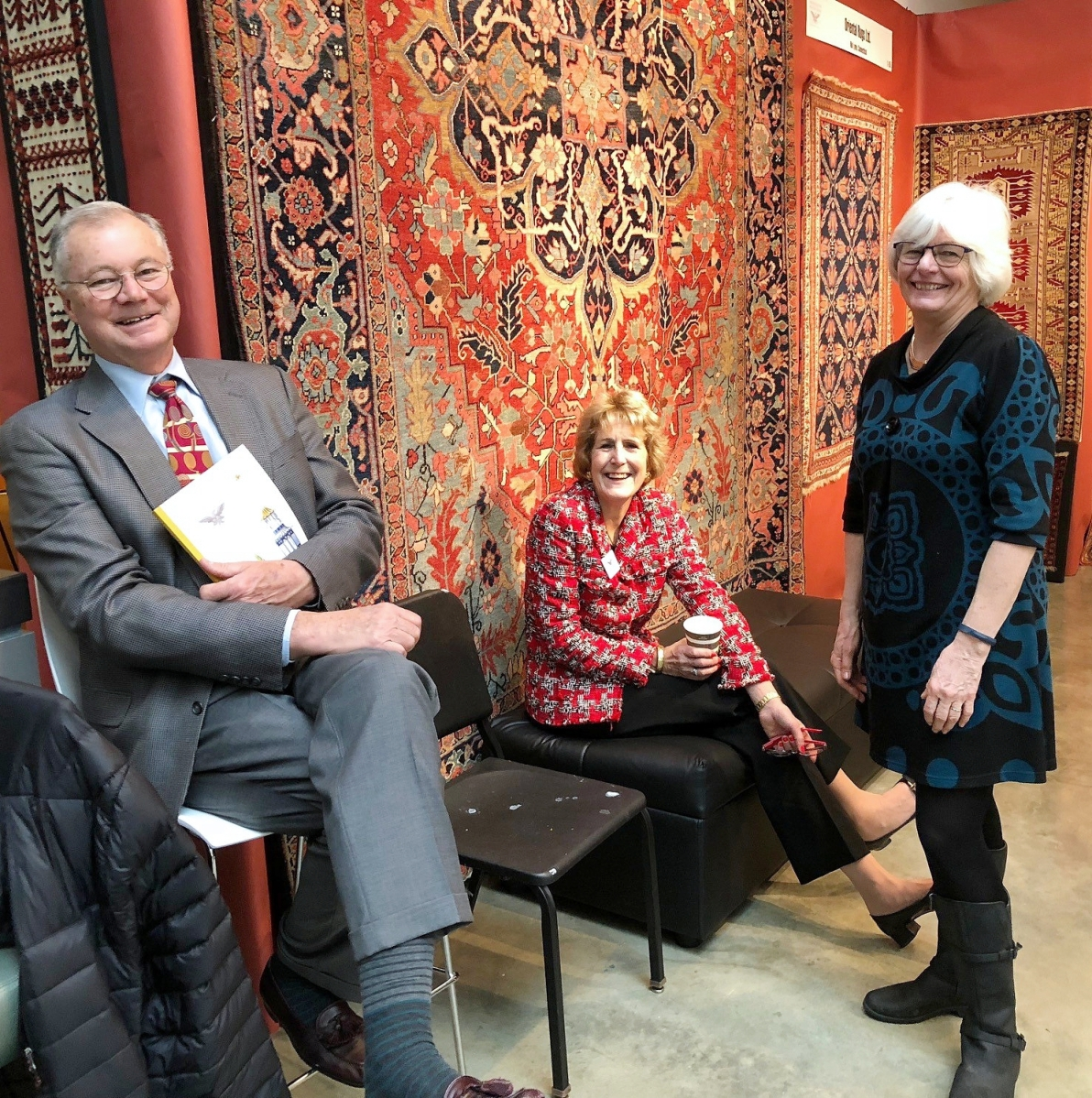 Karen DiSaia, right, manages the show with her husband, Ralph, left. The Oriental rug specialists set up across from Diana Bittel, center, with whom they orchestrate the Philadelphia Antiques and Art Show.