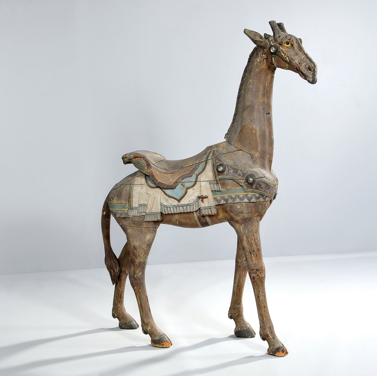 Achieving $61,500, the second highest price of the sale, this giraffe carousel figure retained its original surface. It was attributed to Daniel Muller of the Dentzel Company. In 2011, it sold for more than $100,000 at a Northeast auction.