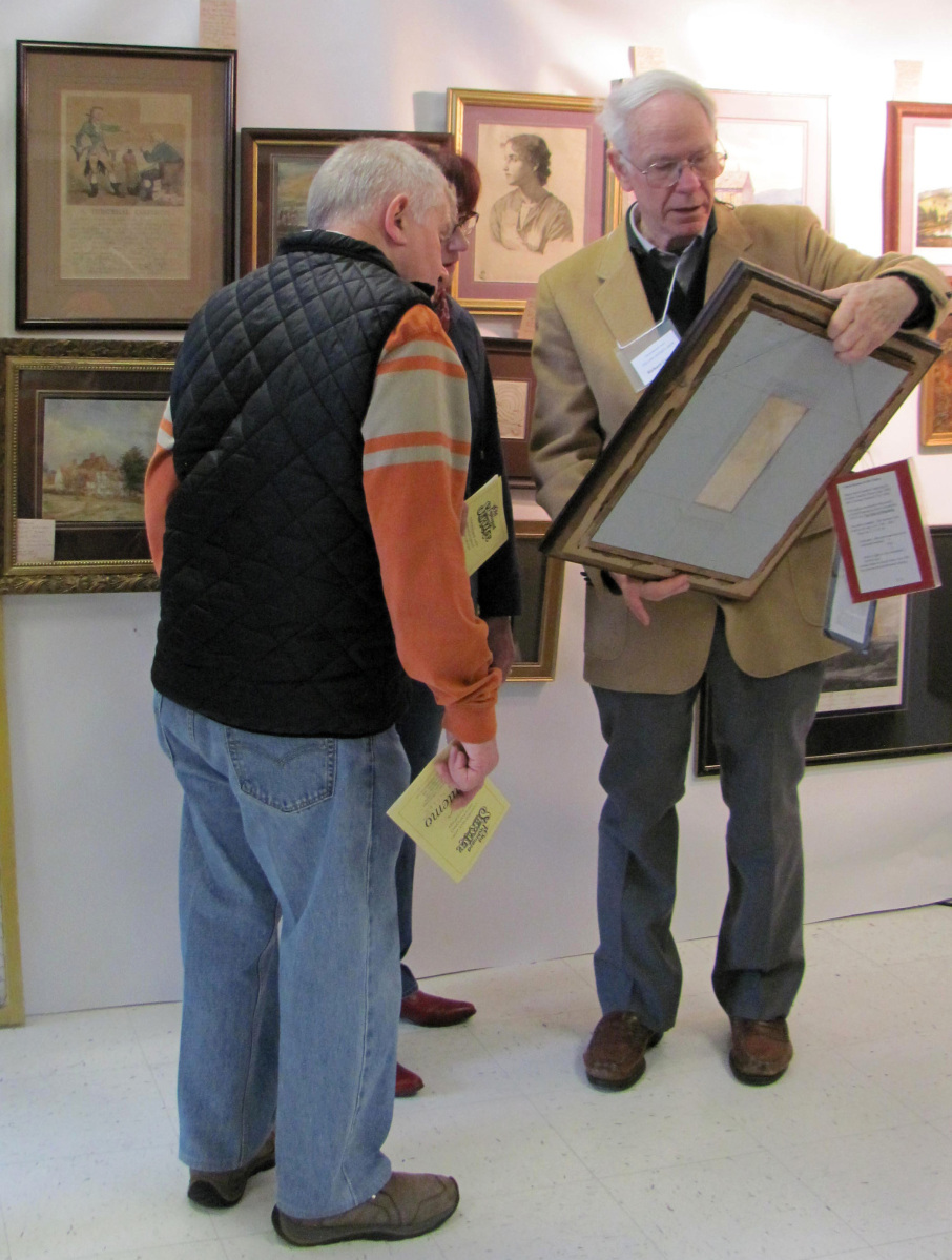 Richard Greene showing one of his pieces to potential buyers.