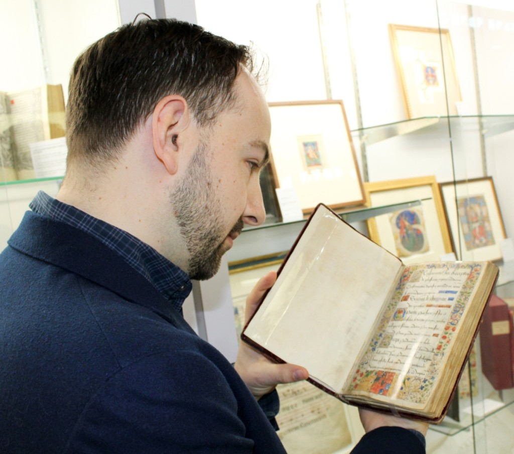 Matt Westerby, archivist and specialist at Les Enluminures, examines an illuminated manuscript comprising a collection of medical recipes and health regimens for the king and court, circa 1515–25. It was bound in a contemporary red velvet binding over wooden boards.
