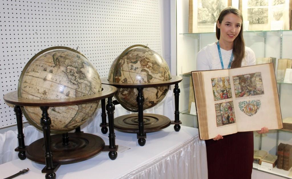Nancy de Bruin shows a rare illustrated book at Antiquariaat de Roo, Zwijndrecht, Holland.