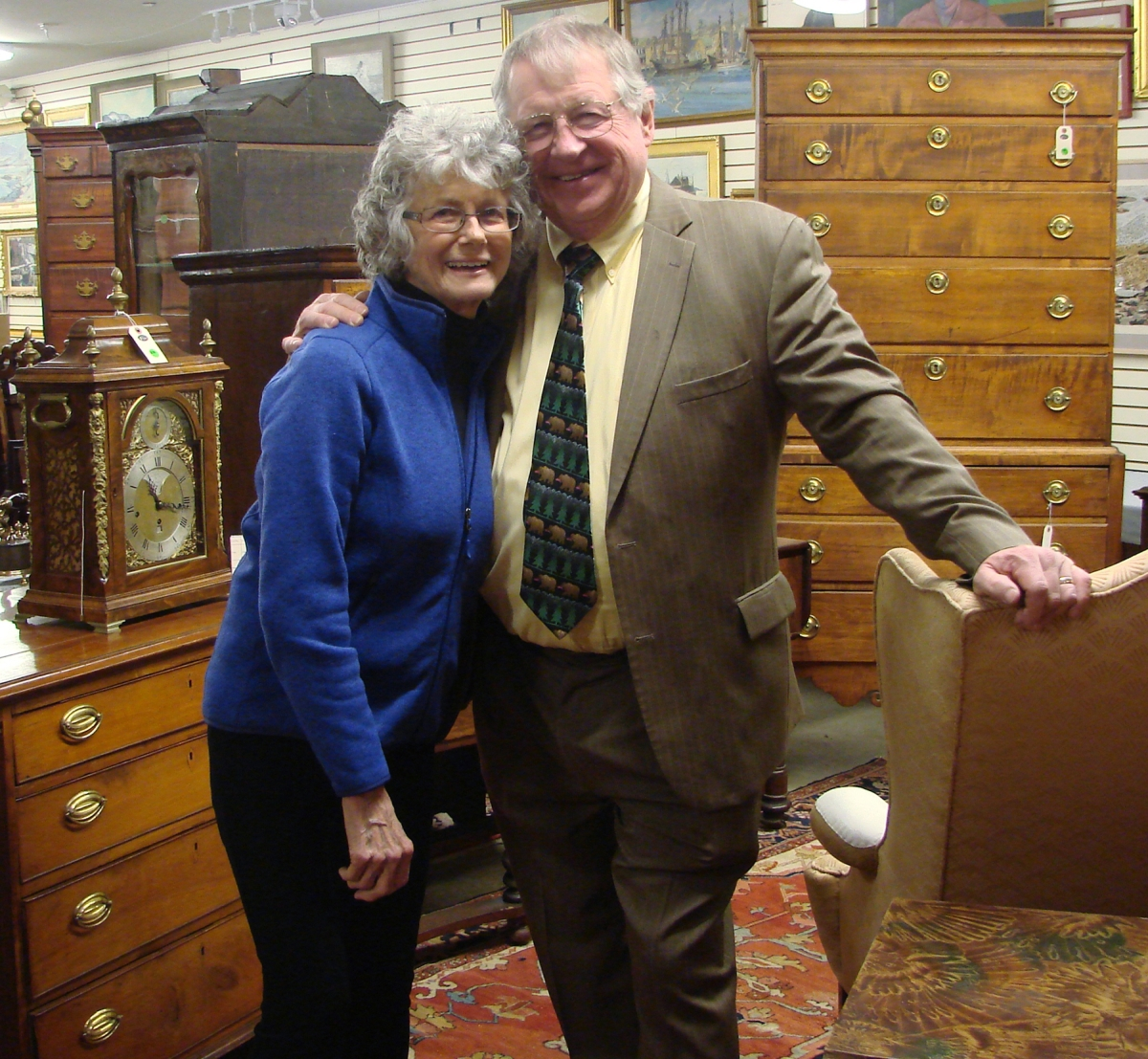 Sandy and Jim Julia pause for a photo during their final fine and decorative arts auction in February 2018.