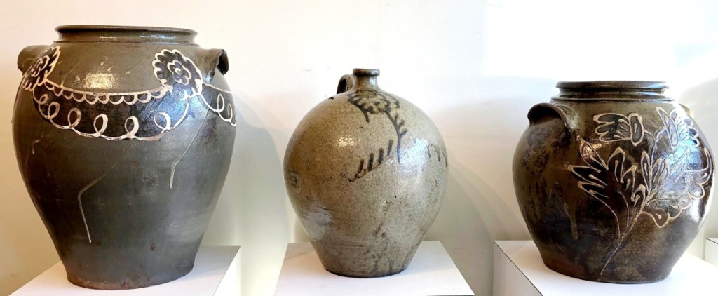 Southern pottery remains the hottest sector of the market. Three alkaline-glazed stoneware pieces from Edgefield, S.C., included, left, a monumental 7-gallon jar, probably by Thomas Chandler, Phoenix Factory, circa 1840. It sold to South Carolina collector Corbett Toussaint in the room for $17,700. A 3-gallon jug, center, attributed to Thomas Chandler, circa 1850, made $5,900 and the 4-gallon jar attributed to Collin Rhodes, circa 1850, sold to a Midwest collector for $29,500.