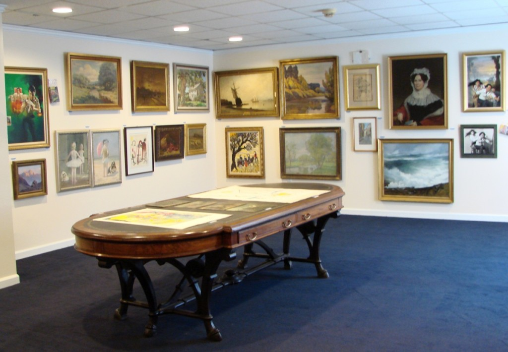 Fontaine's gallery is bright and well lit, and the paintings are displayed for easy viewing.