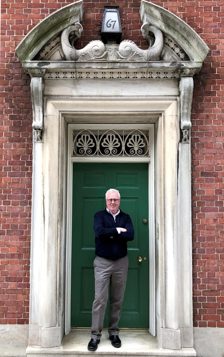ADA Award of Merit winner Peter M. Kenny outside 67 East 93rd Street. Today the private residence of Richard Jenrette, the brick townhouse is part of a complex of buildings designed by the architectural firm Delano & Aldrich and completed between 1927 and 1931.