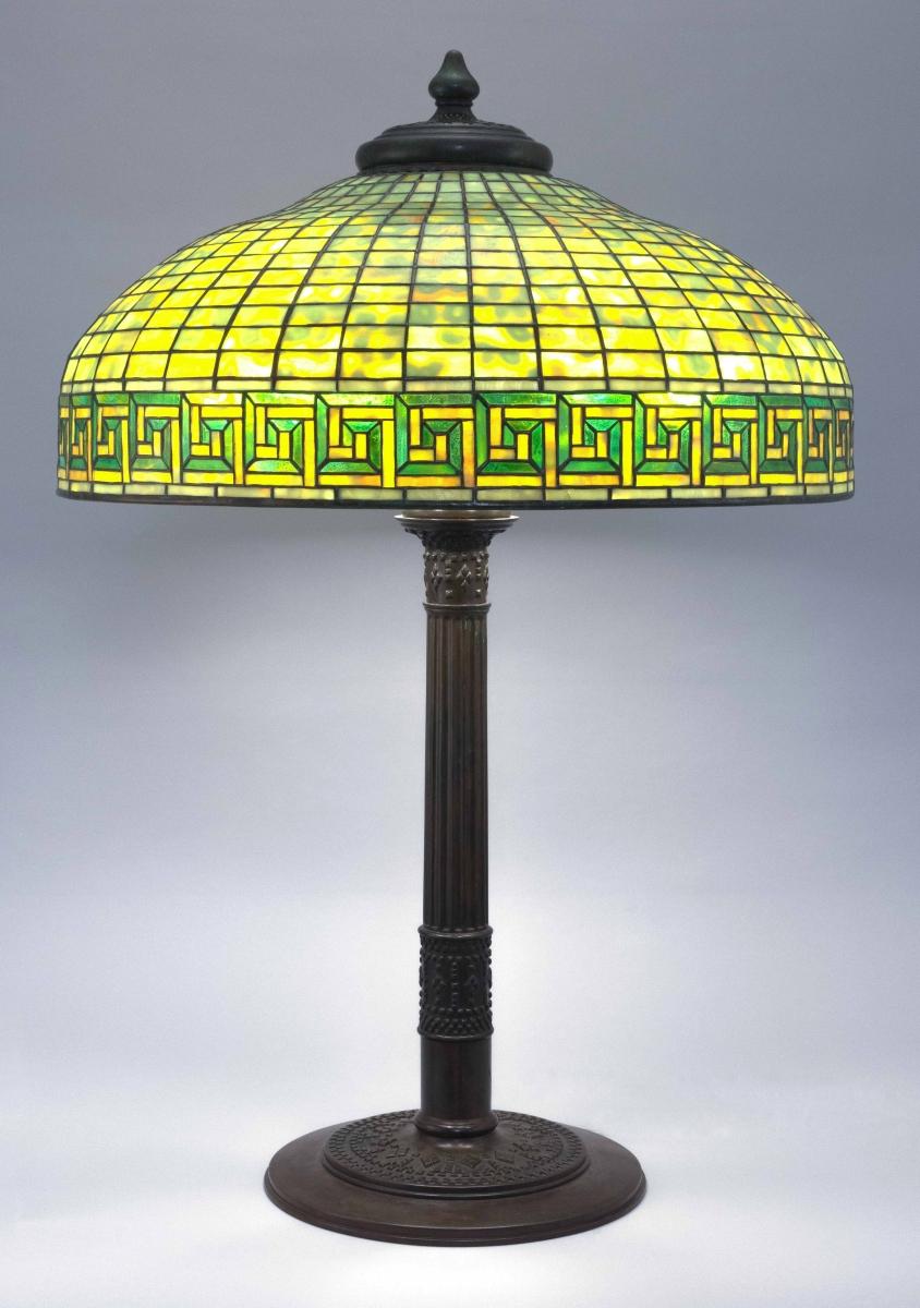 "Tiffany Studios ""Greek Key"" table lamp, early Twentieth Century, 33 inches high, closed at $54,000."