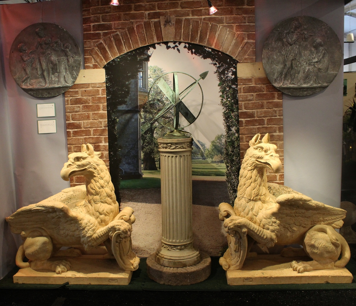 An impressive pair of French terracotta griffins, circa 1860, 44 by 44 inches, guarded an outside wall at Barbara Israel Garden Antiques.