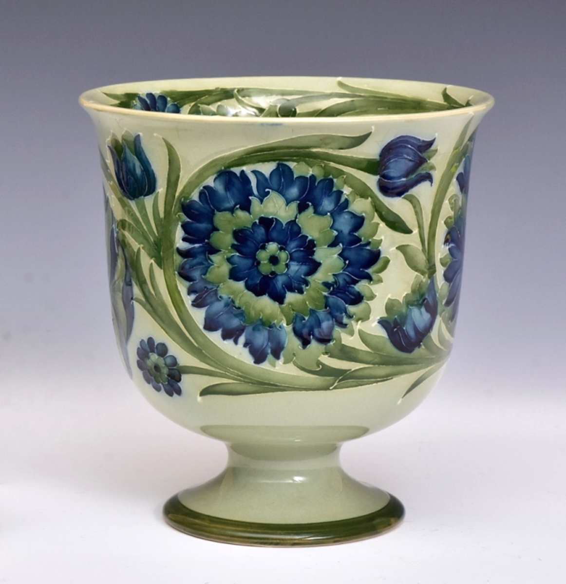 """The top lot of the Moorcroft collection, this 8-inch-high jardiniere in the """"Green Spanish"""" pattern took $6,600 above a $3,000 high estimate."""