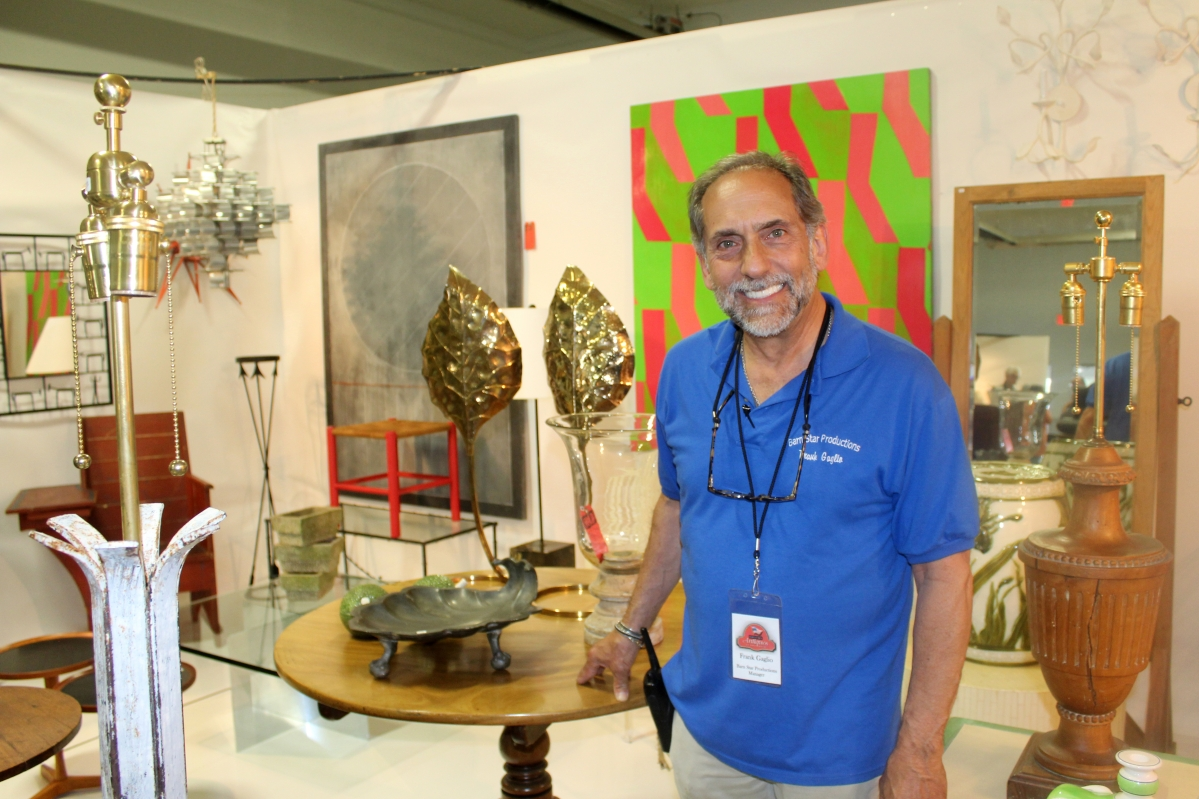 Show promoter Frank Gaglio at the booth of David Bell Antiques in Building E.