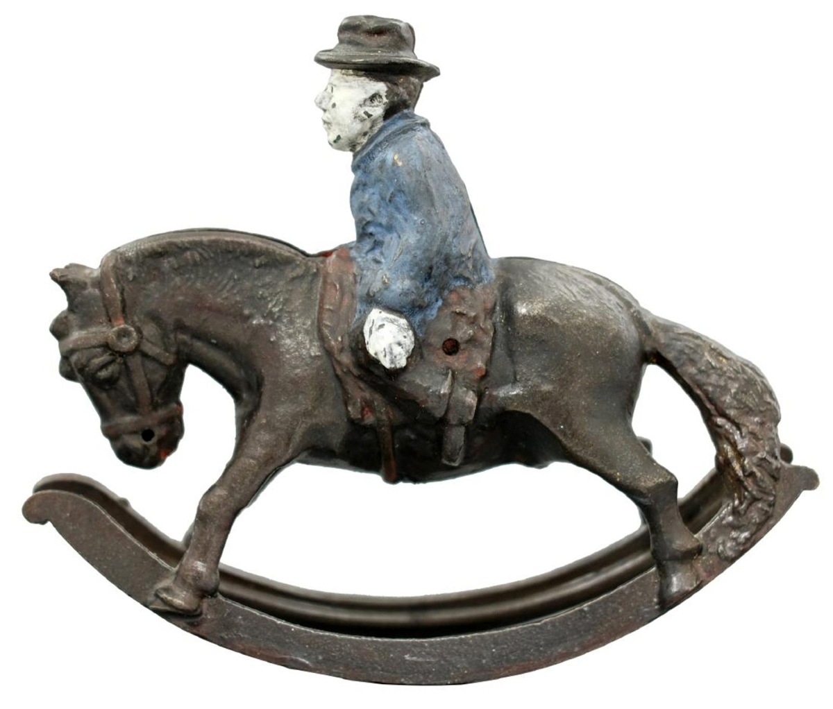 There are only two known Circuit Rider banks, manufacturer unknown, American, circa 1890, cast iron. This one is in pristine condition and sold for just under the high estimate at $24,000. The slot for the coins is in the horse's mane and when the horse rocks it is deposited into the bank.