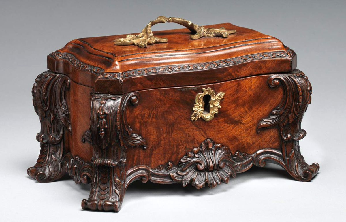 """The Eighteenth Century fascination with tea equipage is evidenced in the Director. This elaborate example shares similarities with some of Chippendale's designs for tea chests. Tea chest, Britain, circa 1760. Mahogany, gilt brass; 6 by 11½ by 6½ inches. Metropolitan Museum of Art, gift of Irwin Untermyer. From """"Chippendale's Director: The Designs and Legacy of a Furniture Maker,"""" Metropolitan Museum of Art."""