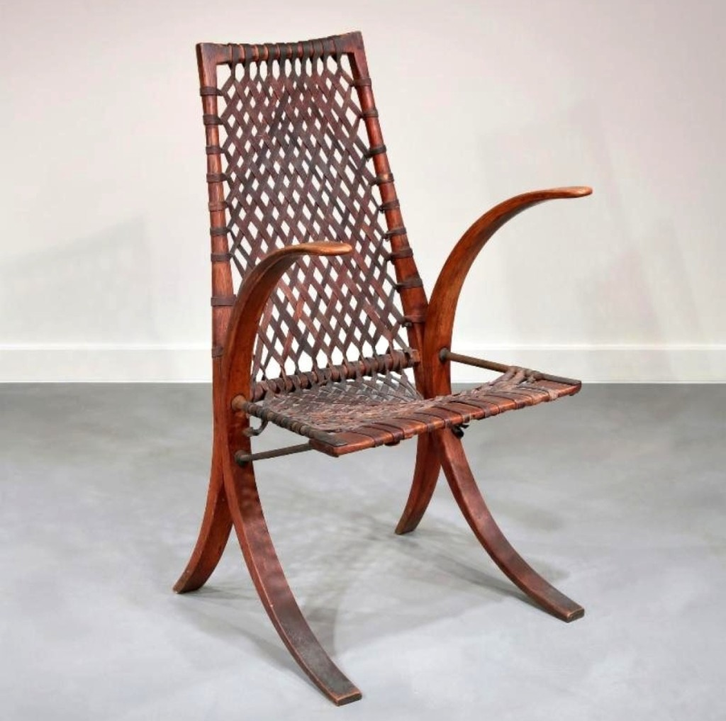 """""""Wagon wheel"""" armchair, Wharton Esherick, signed and dated 1939, oak with wrought iron and leather elements."""