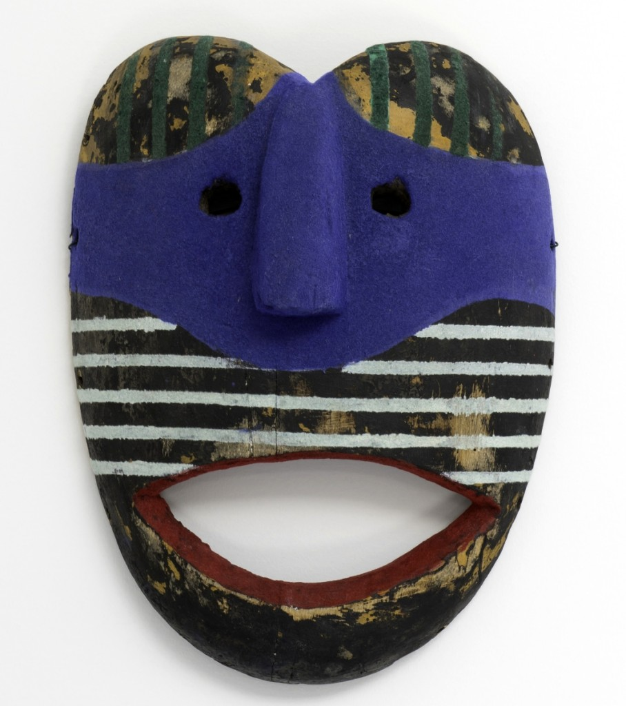 """""""Red Smile (Flocked Series)"""" by Keith Sonnier, 2011, hand painted and flocked found African mask, 12½ by 9½ by 3¾ inches, photo courtesy of the artist and Tripoli Gallery Southampton, ©Keith Sonnier."""