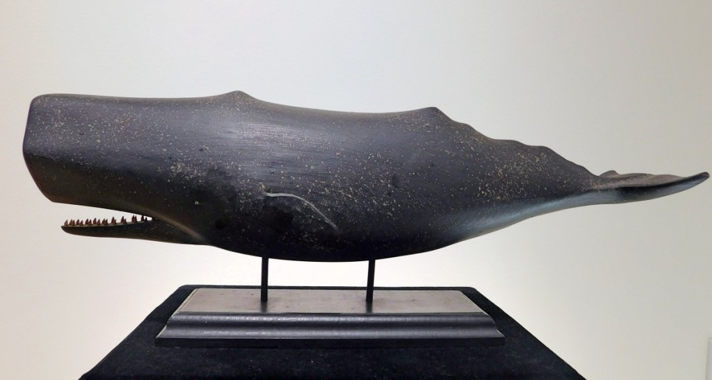 Clark G. Voorhees Jr's father — a landscape painter — founded the Old Lyme Art Colony in Connecticut. Clark followed in his father's footsteps by attending the Art Society of Hartford, but it was not until he later entered the Navy that he began carving whales. This full, wooden-body carving of a sperm whale, mounted on a custom stand, belonged to Ralph Cahoon.