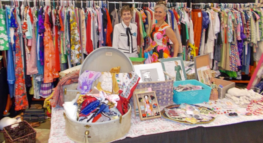 Modeling their antiques, Freddi Brubaker (left) and Charlotte Bevers were also putting the finishing touches on their display of vintage fashions.